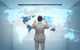 Businessman working with hologram of world map Royalty Free Stock Photography
