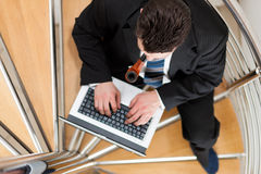 Businessman working at home Stock Images