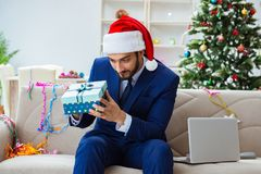 The businessman working at home during christmas. Businessman working at home during christmas Stock Photography