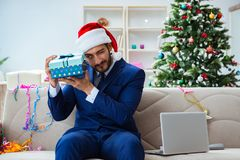 The businessman working at home during christmas. Businessman working at home during christmas Royalty Free Stock Images