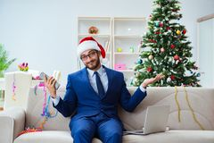 The businessman working at home during christmas. Businessman working at home during christmas Stock Image