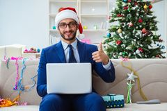 The businessman working at home during christmas Royalty Free Stock Images