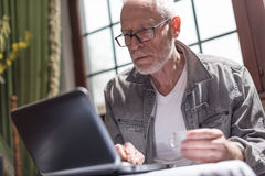 Businessman working at home, hard light effect. Senior businessman working at home, hard light effect Royalty Free Stock Photo