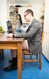 Businessman Working From Home. Businessman is working from home and having a teleconference, wearing no pants. how good that cameras always only show a little Stock Photo