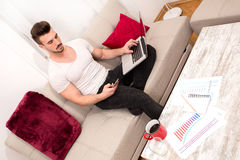 Businessman working at home Stock Photography