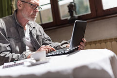 Businessman working at home. Senior businessman working at home Stock Image