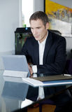 Businessman working at home Royalty Free Stock Photos