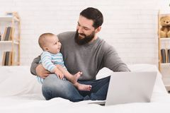 Businessman working from home and watching child royalty free stock photo