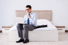 The businessman working in hotel room Royalty Free Stock Image