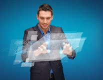 Businessman working with imaginary virtual screen Royalty Free Stock Images