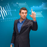 Businessman working with imaginary virtual screen Stock Photo