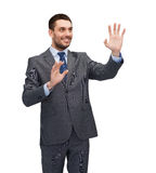 Businessman working with imaginary virtual screen Stock Image