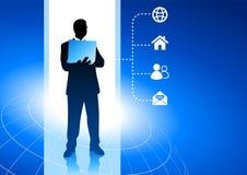 Businessman working with internet symbols Stock Photo