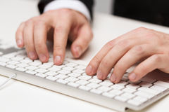 Businessman working with keyboard. Business, technology, internet and office concept - close up of businessman hands working with keyboard Stock Photos