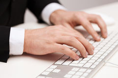 Businessman working with keyboard. Business, technology, internet and office concept - close up of businessman hands working with keyboard Stock Photo