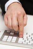 Businessman working with keyboard. Business, technology, internet and office concept - close up of businessman hands working with keyboard Royalty Free Stock Photo