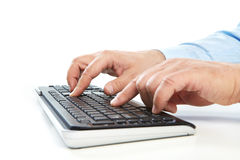 Businessman working with keyboard Royalty Free Stock Image
