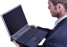 Businessman working on laptop Stock Images