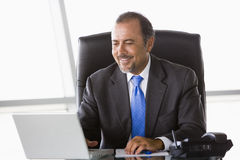 Businessman working at laptop. In office Stock Image