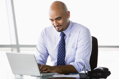 Businessman working at laptop. In office Stock Photography
