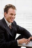 Businessman working on laptop Stock Image
