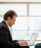 Businessman working on laptop Royalty Free Stock Photos