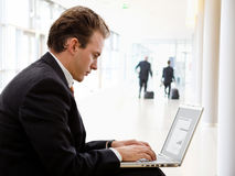Businessman working on laptop. Computer at office lobby Royalty Free Stock Image
