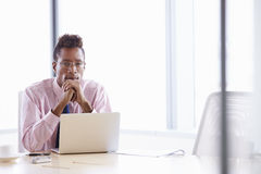 Businessman Working On Laptop At Boardroom Table Royalty Free Stock Photos