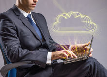 The businessman working with laptop in cloud computing concept Stock Image