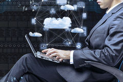 The businessman working with laptop in cloud computing concept Royalty Free Stock Image