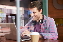 Businessman Working On Laptop In Coffee Shop Stock Images