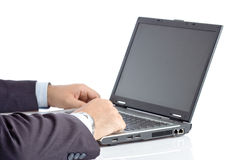 Businessman working on a laptop computer stock images