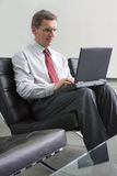 Businessman working with laptop computer Stock Image