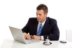 Businessman working on laptop computer Stock Photos