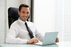 Businessman working with a laptop computer Stock Image