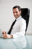 Businessman working with a laptop computer Royalty Free Stock Photography