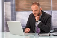 Businessman working with laptop computer Stock Photos