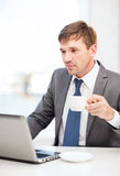 Businessman working with laptop computer Royalty Free Stock Photo