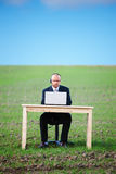Businessman working on laptop beside copyspace Royalty Free Stock Photos