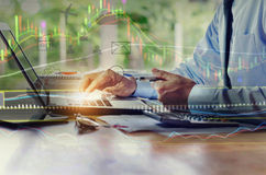 Businessman working with laptop, Double exposure concept stock t Royalty Free Stock Images