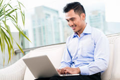 Businessman working with laptop from home Stock Photos