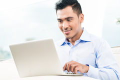Businessman working with laptop from home Royalty Free Stock Photo