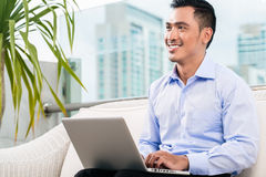 Businessman working with laptop from home Royalty Free Stock Photos