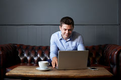 Businessman Working On Laptop In Internet Cafe Royalty Free Stock Images