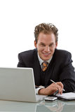 Businessman working on laptop isolated Royalty Free Stock Images