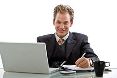 Businessman working on laptop isolated Royalty Free Stock Photos
