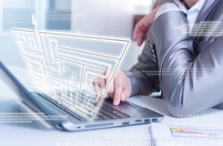 Businessman working on laptop maze solving, business strategy Stock Images