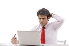 Businessman working on a laptop. In an office Stock Photography