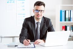 Businessman working with laptop. In an office Royalty Free Stock Images