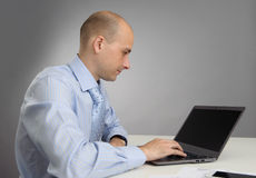 Businessman working with laptop in office Royalty Free Stock Image